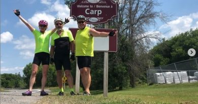 Carp residents Nicolette Frosst, Gordon Frosst and Jeff Hemstreet celebrate arriving home on July 28. Courtesy Coast2CoastBikeTour