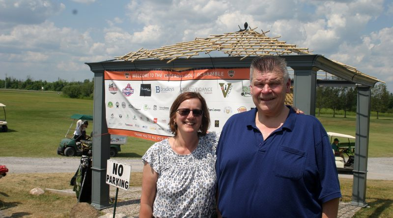West Carleton junior C Inferno general manager and team owner John Miolta, posing at last Saturday's Inferno golf tournament with wife Bev Windsor-Miolta, spoke to West Carleton Online about the upcoming hockey season. Photo by Jake Davies