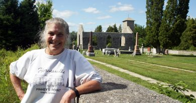 Megs Colbourn, photographed beside the St. Mary's Anglican Church cemetary at Pinhey's Point, is a sixth generation Pinhey. She shared some historic, and a few spooky stories with West Carleton Online last week. Photo by Jake Davies