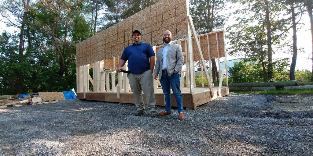 Simon Feizo-Gas and Patrick Lamothe pose during the model home construction's early days. Courtesy Feizo-Gas
