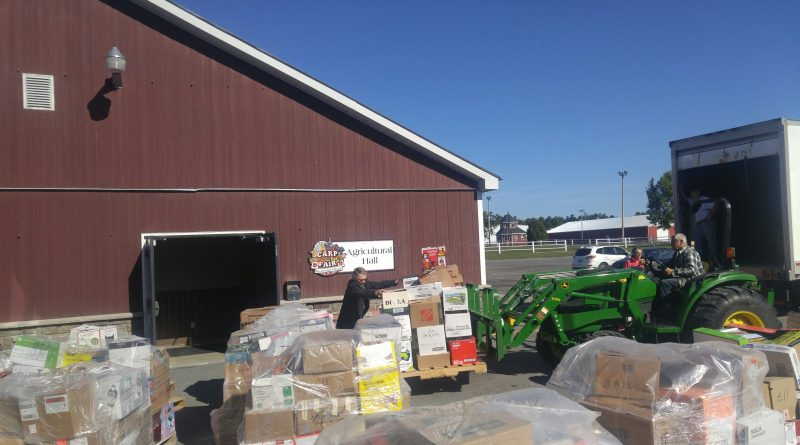 That's a lot of books. WCFAC volunteers and a tractor help unload more than 11,000 books in time for tomorrow's WCFAC Colossal Book Sale. Photo by Jake Davies