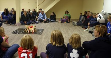Nearly 60 past, present and future Camp Woolsey campers attended an unfortunately indoor campfire to celebrate 80 years. Photo by Jake Davies