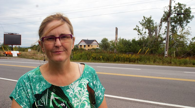 Dr. Jen Purdy, photographed in Dunrobin while a house destroyed by last year's tornado is rebuilt in the background, says the Greens are the only ones with a feasible plan for the environment. Photo by Jake Davies