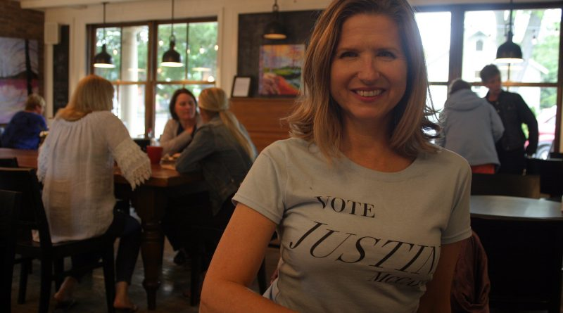 Federal Conservative candidate Justina McCaffrey, photographed at Alice's Village Cafe in her nomination t-shirt, says she wants to put money back in voters' pockets. Photo by Jake Davies