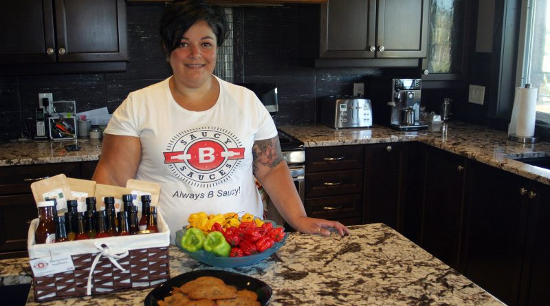 Carp's Bahareh Tabrizi in her kitchen with her sauces and some spicy chocolate chip cookies. Photo by Jake Davies