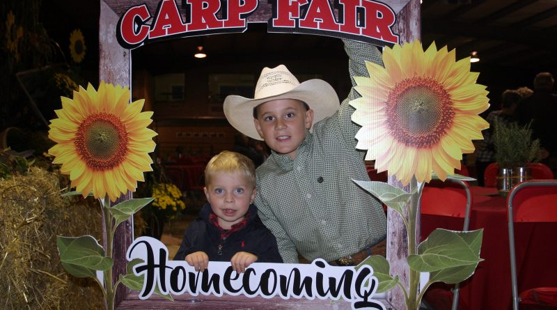 Future Carp Fair directors, from left, William Daley, 3, and Jack Findlay, 8, help kick off Homecoming at the 156th Carp Fair. Photo by Jake Davies