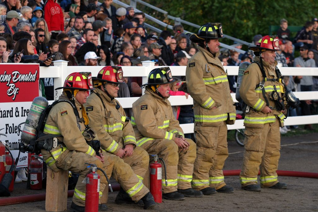 Volunteer firefighters, led by Chris Burke (Centre) are at the ready during Thursday's demolition derby. Photo by Jake Davies