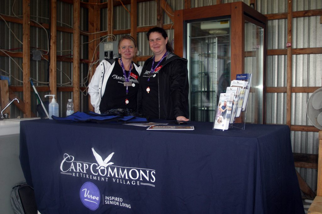 From left, the Carp Commons Retirement Village's Rebekah Gunning and Melanie Webber hosted those collected in the senior shade barn. Photo by Jake Davies
