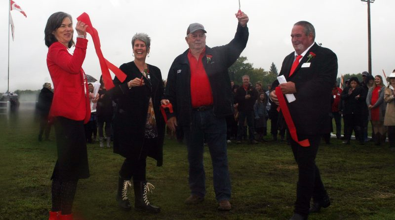 From left, 2019 Homecrafts President Martha Palmer, past president Laura Campbell (2007), past president Lorne Montgomery (1989) and Agriculture President Doug Norton cut the Carp Fair ribbon at today's ceremonial parade. Photo by Jake Davies