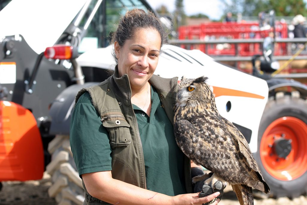 Ray's Reptiles' Tracy Chaves and Khaleesi, a Eurasion Eagle Owl, pose for a photo. Photo by Jake Davies