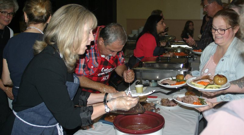 From left, MPP Dr. Merrilee Fullterton serves up some stuffing while Coun. Eli El-Chantiry slices up some roast beef. Photo by Jake Davies