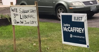 The sign on the left, threatening violence, has cominated Kanata-Carleton election conversation today (Sept. 23). Courtesy Karen McCrimmon/Twitter
