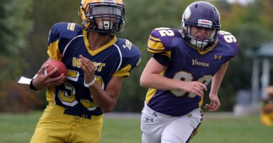 Wolverine quarterback Keegan Brunet outruns a Gatineau tackler during a Sept. 1 NCAFA game. Brunet is competing at the World Youth Football Championship in Ohio this week and was named to the NCAFA All-Star team yesterday, Photo by Jake Davies
