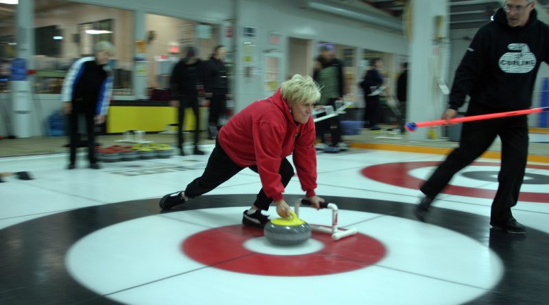 Carp resident Maria Murphy works on her delivery during last Saturday's Try Curling for Free event at the Huntley Curling Club. Photo by Jake Davies