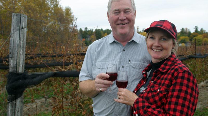 Shaun McEwan and Lorraine Mastersmith enjoy a glass of their own wine in their own vineyard as KIN's new owners work through their first harvest. Photo by Jake Davies