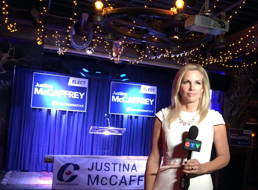 CTV reporter Patricia Boal stands in front of Conservative Candidate Justina McCaffrey's stage on Election Night - a stage that looks like it cost more than Green Party candidate Purdy's entire Election Night party. Courtesy Twitter/Patricia Boal