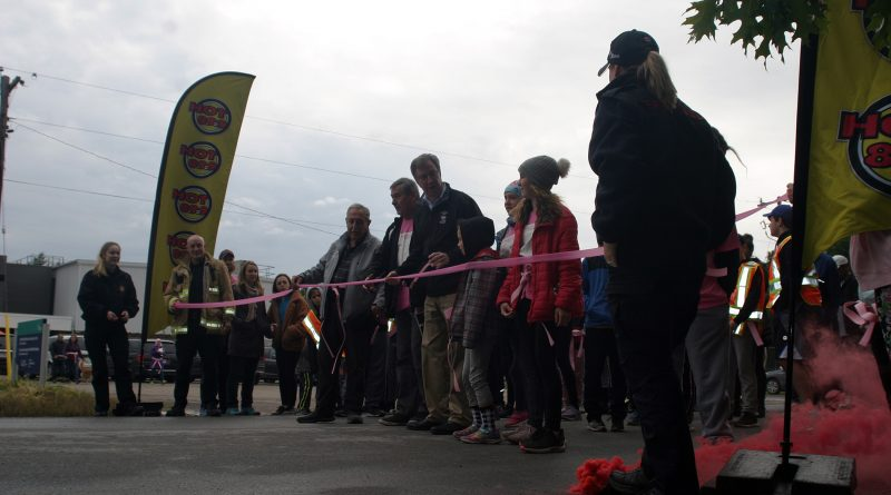 Constance Bay Taekwon Do teacher Ron Sparks and his grandaughter Summer cut the ribbon to start the Kicking Breast Cancer in the Butt walk/run last Sunday. Photo by Jake Davies