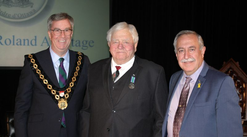 From left, Mayor Jim Watson, Dr. Roly Armitage and Coun. Eli El-Chantiry pose for a photo following the medal presentation. Photo by Jake Davies