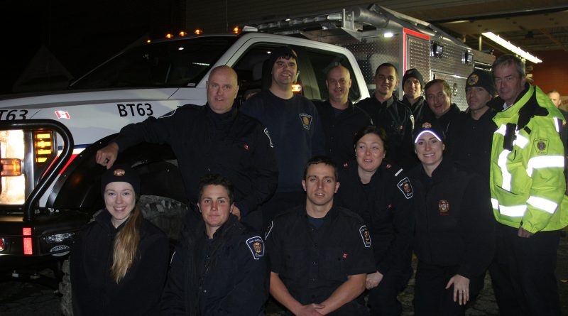 Constance Bay volunteer firefighters pose with their new tool - Brush Truck 63. Photo by Jake Davies