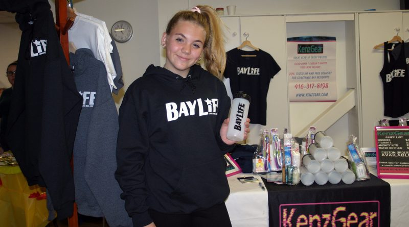 Mackenzie Aldis, 13, shows off her line of BayLife merch under the KenzGear moniker at last Saturday's CBCM Fall Fair. Photo by Jake Davies