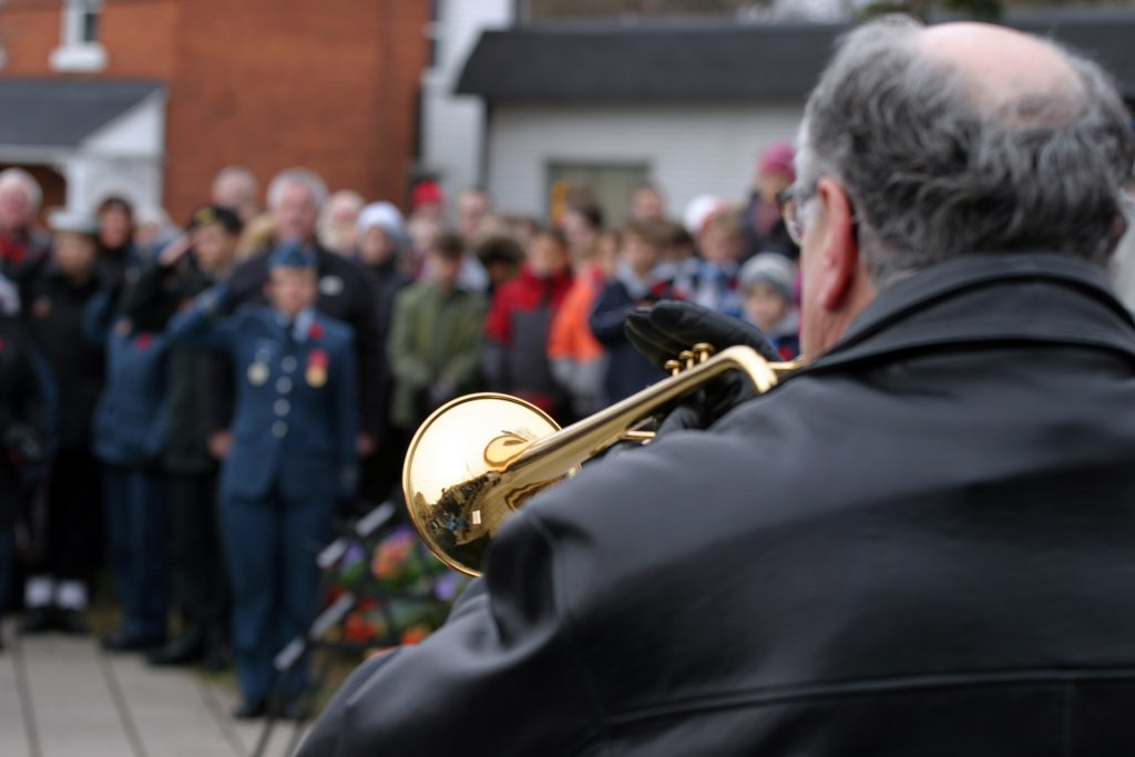 Trumpeter John Weiss performs the Last Post. Photo by Jake Davies