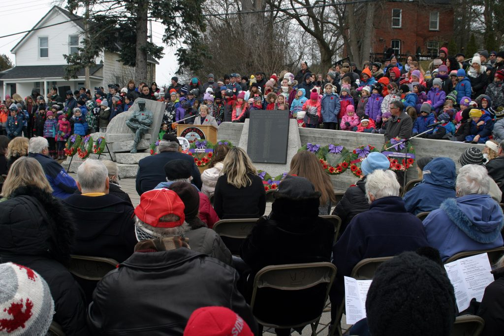 Rev. Debbie Roi gives the blessing/benediction at the very well attended West Carleton War Memorial Remembrance Day Service earlier today. Photo by Jake Davies