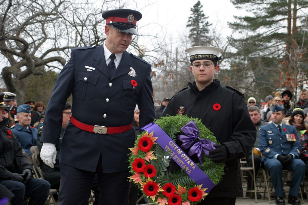 Carp resident and Ottawa police member Const. Ed Barry lays a wreath at the memorial with his daughter Emily a member of the Royal Canadian Sea Cadets Corps Centurion. Photo by Jake Davies