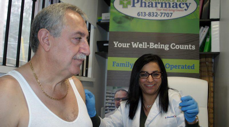 Pharmacist Tamara Awada gives Coun. Eli El-Chantiry his annual flu shot at the Constance Bay Pharmacy Thursday, Nov. 14. Photo by Jake Davies