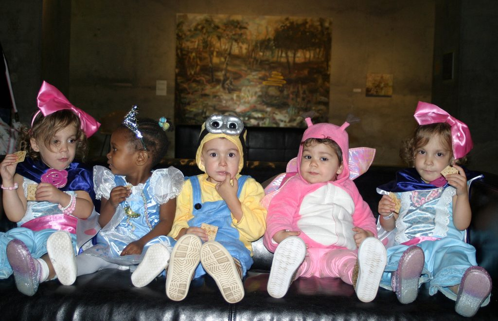 From left, Stittsville's Abby, 2, Tianna, 2, Gustavo, 2, Laura, 1 and Ashleigh, 2, rest their tiny feet at the Diefenbunker Toddlers Hallowe'en Hunt. Photo by Jake Davies