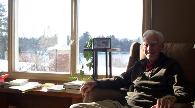 Rev, Jack Lougheed sits in the family home his wife grew up in with a beautiful living-room view of the Grand River in this photo taken Nov. 12. Photo by Jake Davies