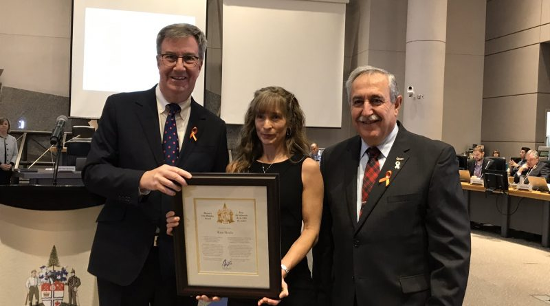 Mayor Jim Watson and Coun. Eli El-Chantiry present Kim Steele with the Mayor's City Builder award this morning (Nov. 27). Courtesy the City of Ottawa