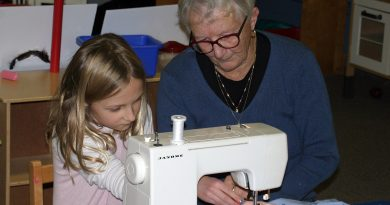 Cherith Cook shows Charlotte MacIsaac how to use a sewing maching at the So You Can Sew event Nov. 7. Photo by Jake Davies