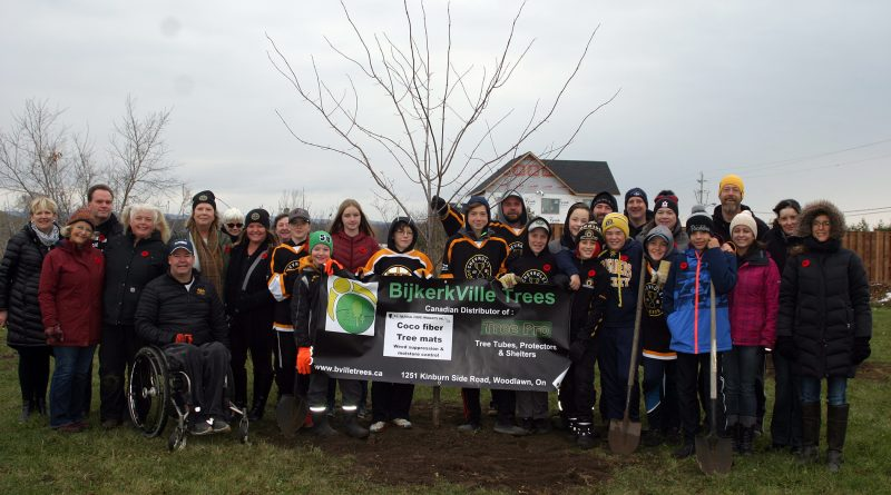 The Warriors, parents, coaches, members of the Women's Institute, the DCA, sponsors and community members pose beside the freshly planted Canadian Red Maple last fall provided by BijkerkVille Trees. Photo by Jake Davies