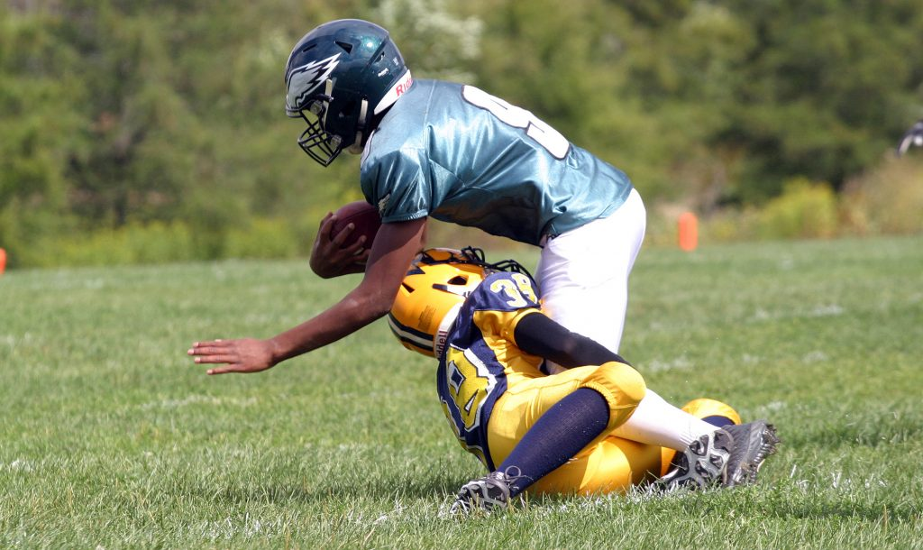 Wolverines DB Mack Thurston makes a tough, open field tackle against the Nepean Eagles earlier in the season. Photo by Jake Davies