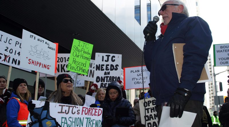 Constance Bay's Gerry Blyth speaks at Saturday's Stop the Flooding rally outside the IJC office. Photo by Jake Davies