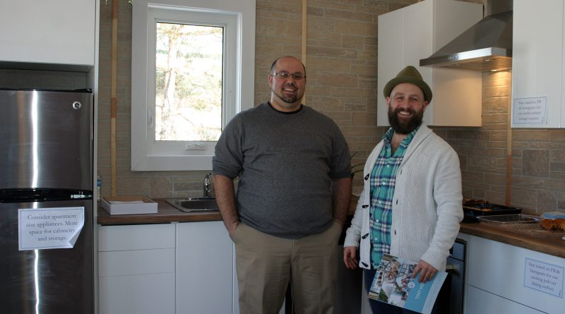 Humble Creek Homes' Simon Feizo-Gas and Patrick Lamothe pose in the kitchen of their tiny home. Photo by Jake Davies