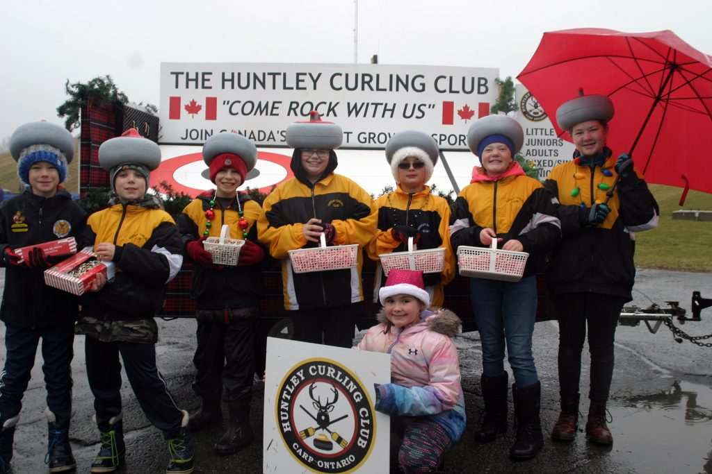 The Huntley Curling Club needed fewer umbrellas thanks to some inventive headwear. Photo by Jake Davies