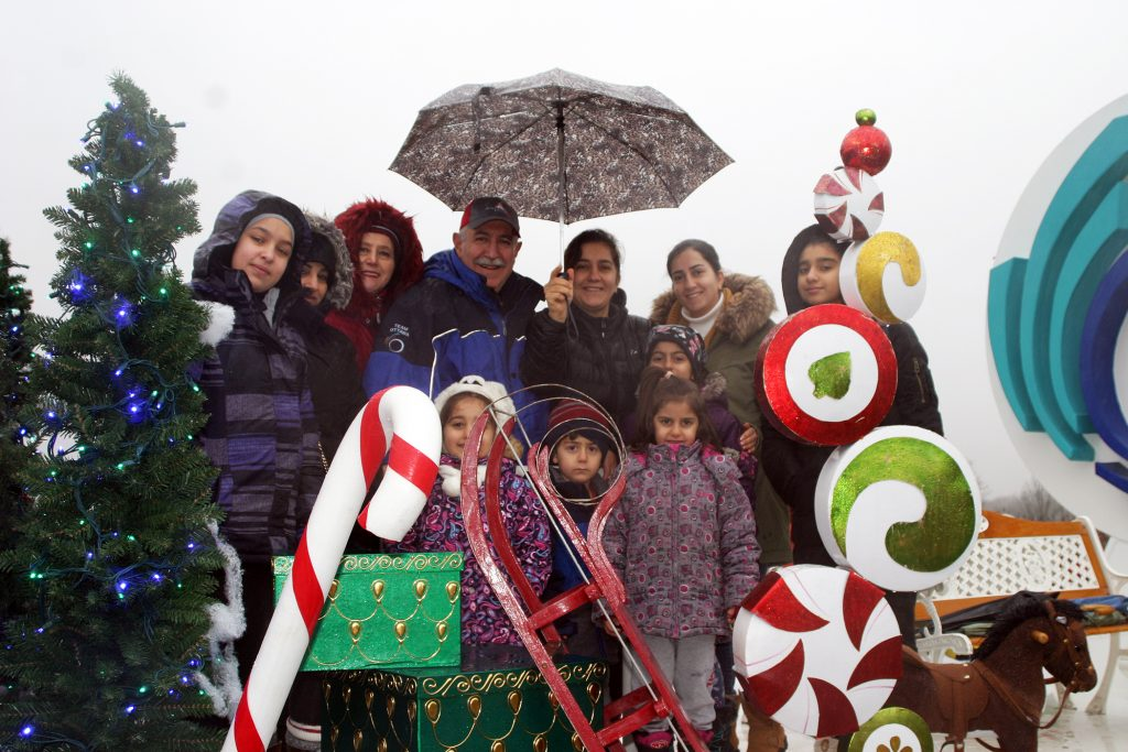 Coun. Eli El-Chantiry, his wife Maha and their friends and family on the City of Ottawa float. Photo by Jake Davies