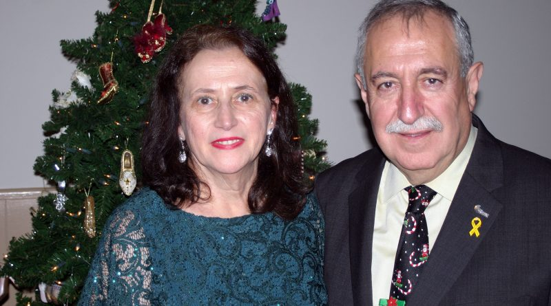 Maha and Councillor Eli El-Chantiry pose for a photo at their annual Christmas party last Friday. Photo by Jake Davies