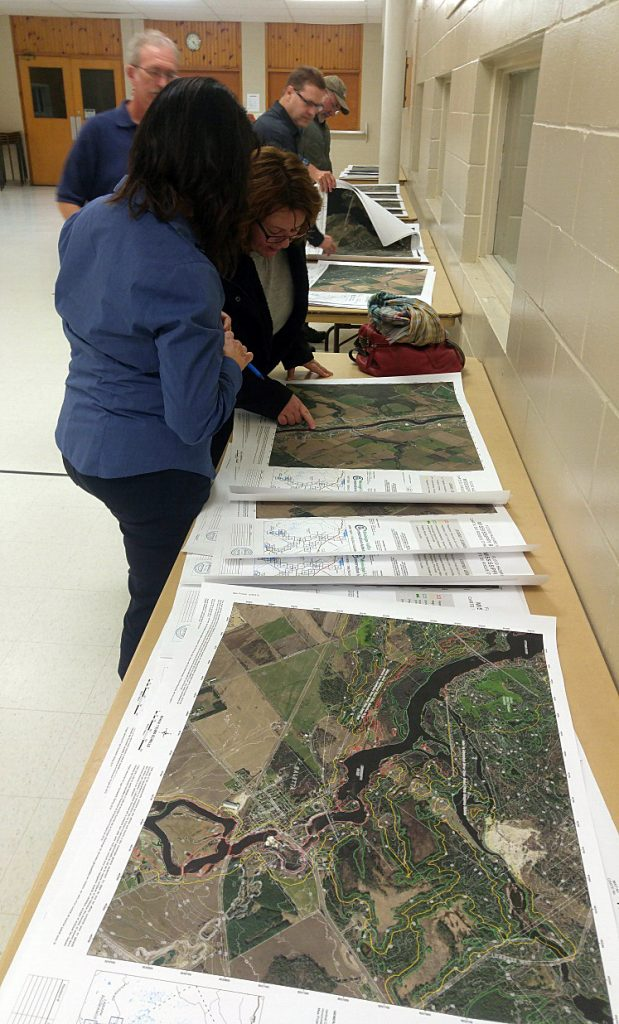 Members of the public review new floodplain mapping at an information session in Pakenham last week. Photo by Jake Davies