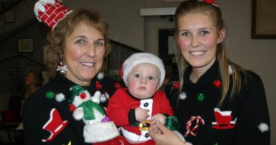 This threesome was awarded best Christmas sweater at last Thursday's cookie exchange in Galetta. From left are grandma Barb Cavanagh, five-month-old Bennett Gwalchmai and mom Cassandra Cavanagh. Photo by Jake Davies