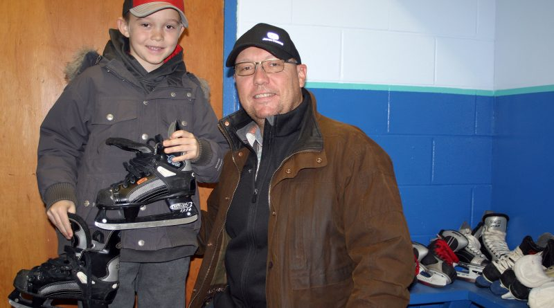 Constance Bay's Burke, 8, and dad Corey Griffin dropped by Saturday's WCOHL equipment exchange to prepare for the upcoming outdoor hockey season. Photo by Jake Davies