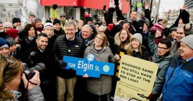 The mayor and others celebrate the reopening of Elgin Street Dec. 16. Courtesy City of Ottawa