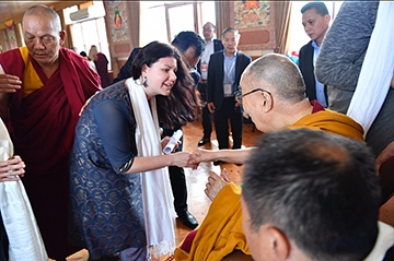 Dunrobin's Arya Landers meets the 14th Dalai Lama in Bogh Gaya, India and presents him with two poems last week. Courtesy the house of H. H. The Dalai Lama