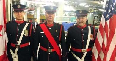 From left, OFS Honour Guards Peter Roy-Smith, Bill Bell and Graham Forrester pose for a photo moments before heading on to Ottawa Senator ice as the colour guard for the evening's national anthem singing. Photo by Jake Davies