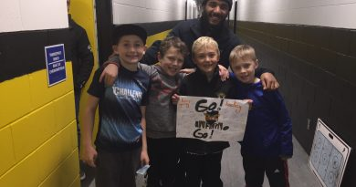 West Carleton Inferno Captain Josh McColl-Williams poses with young fans who won the Jan. 5 Cheer Poster competition. Coutesy the Inferno