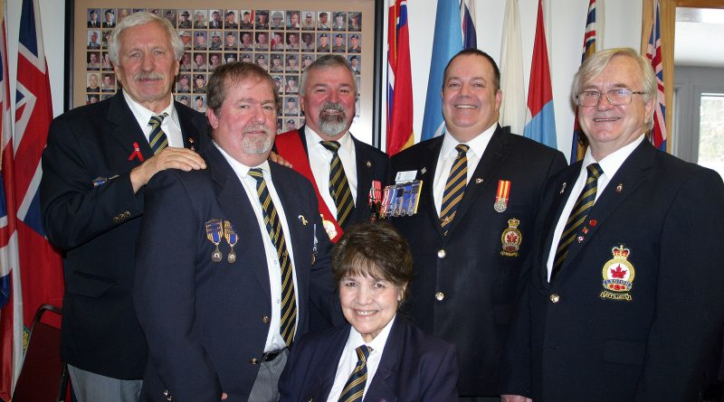 From left, Branch 616 executive Tom Watters, John Woodbeck, Sergeant-at-Arms Rob Gallant, Secretary Arleen Morrow, Zone Commander and Branch 240 President Rob Madore, and Vice President Bogdan Procyk pose for a photo on New Year's Day. Photo by Jake Davies