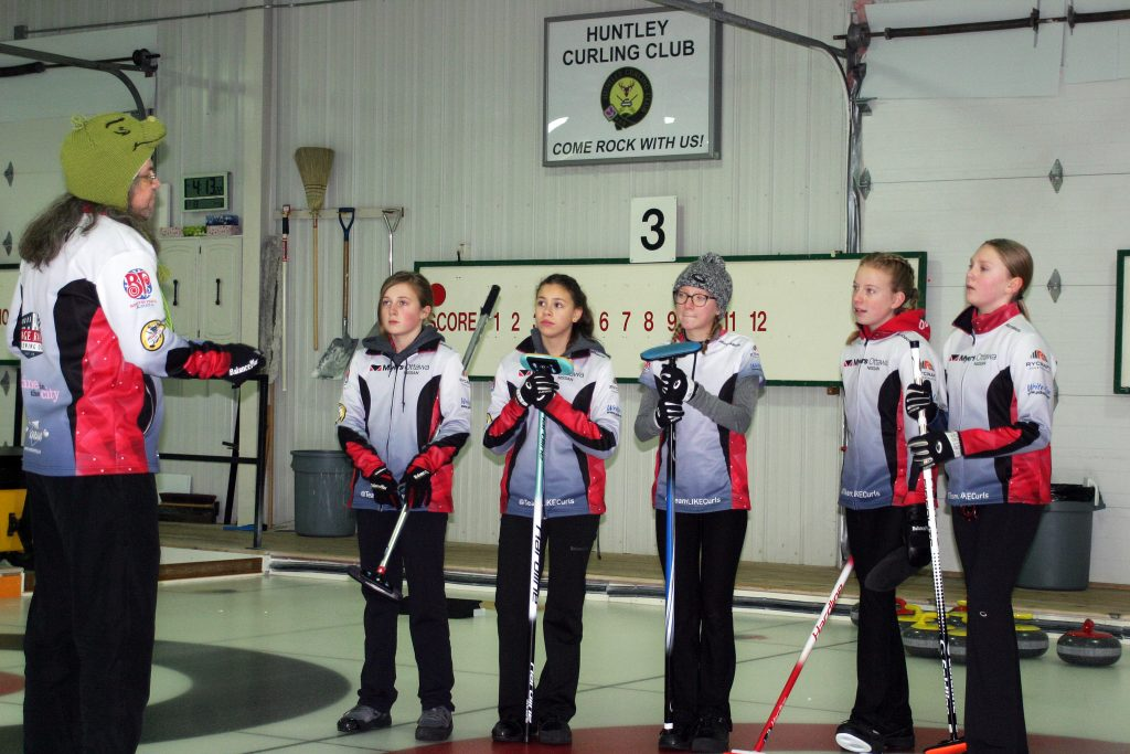 Team LIKE gets down to practice, led by coach Lou Frlan (far left) at the Huntley Curling Club last Monday. Photo by Jake Davies