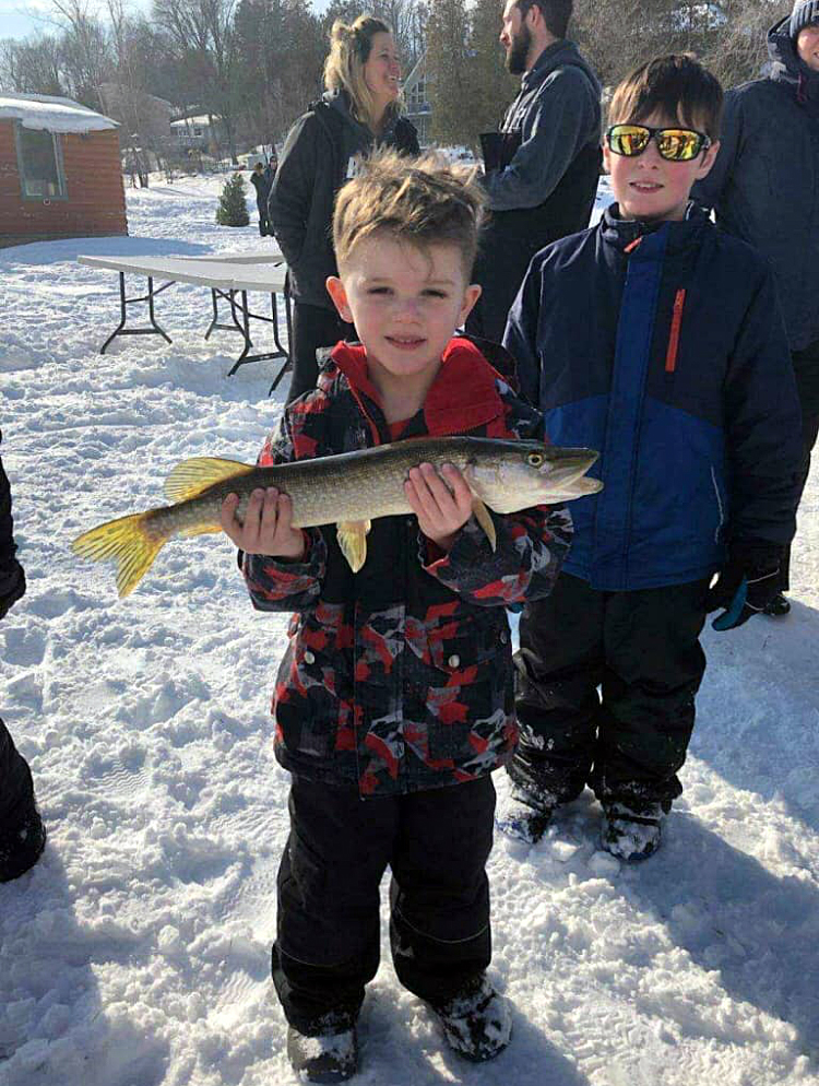 Foster Lessard shows off his mighty big fish. Courtesy Shadine Robinson
