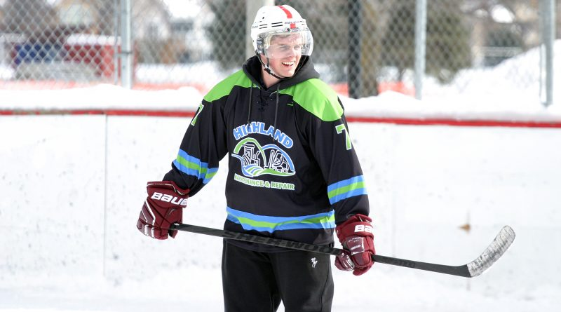 Hockey4Humanity organizer and West Carleton volunteer firefighter Alex Carlson gets a litte game action in. Photo by Jake Davies